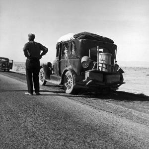 Oakie Family Stalled on Desolate Track of Highway in Desert in Southern California by Dorothea Lange