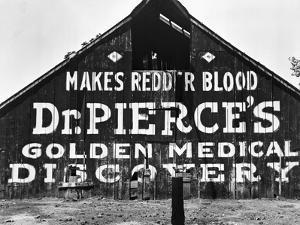 Patent Medicine Sign on A Barn by Dorothea Lange