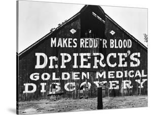 Patent Medicine Sign on A Barn by Dorothea Lange
