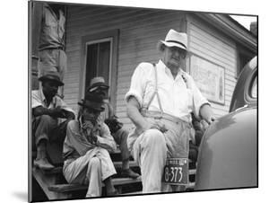 Plantation overseer and his field hands, Mississippi, 1936 by Dorothea Lange