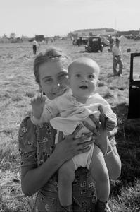 Potato Picking Mother with Baby by Dorothea Lange