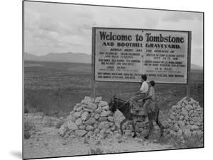 Sign entering Tombstone, Arizona, 1937 by Dorothea Lange