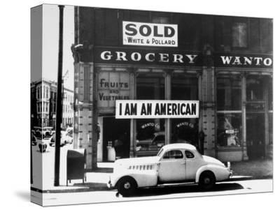"Store Sign Reads, ""I am an American,"" After Pearl Harbor Attack, and ""Sold"", Following Evacuation"
