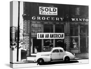 """Store Sign Reads, """"I am an American,"""" After Pearl Harbor Attack, and """"Sold"""", Following Evacuation by Dorothea Lange"""
