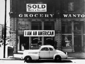 "Store Sign Reads, ""I am an American,"" After Pearl Harbor Attack, and ""Sold"", Following Evacuation by Dorothea Lange"