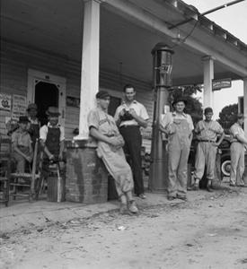 Suiting Up for Baseball at the Gasoline Station by Dorothea Lange