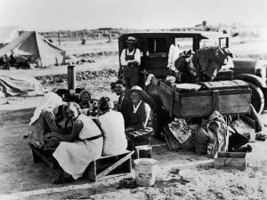 Suppertime for Oklahoma Family Follow Crops from California to Washington during the Depression by Dorothea Lange