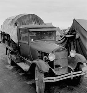 Truck Parked by Tent in Fsa Site by Dorothea Lange