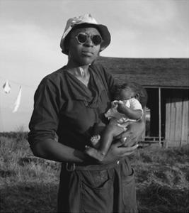 Wife and Child of Tractor Driver by Dorothea Lange