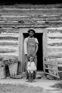 Young Sharecropper and His First Child by Dorothea Lange