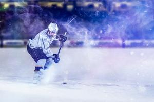 Ice Hockey Player in Action Kicking with Stick by dotshock