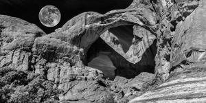 Double Arch with Moon at Arches National Park, Moab, Utah, USA