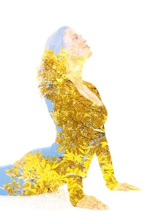 https://imgc.artprintimages.com/img/print/double-exposure-portrait-of-young-woman-performing-yoga-asana_u-l-q105ngi0.jpg?p=0