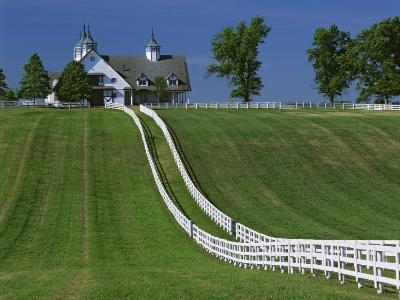 Double White Fence Flows from an Elegant Horse Barn, Woodford County, Kentucky, USA-Dennis Flaherty-Photographic Print
