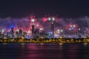 Fireworks over Melbourne city skyline as seen from Port Philip Bay on New Year's Eve 2017. by Doug Gimesy