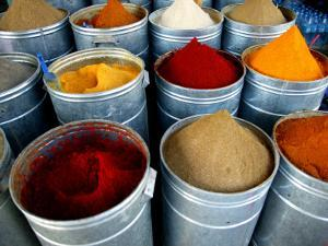 Colourful Piles of Spices on Display in Spice Souk by Doug McKinlay
