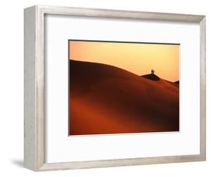 Couple on Dunes in the Erg Oriental Sand Sea, Ghadhames, Libya by Doug McKinlay