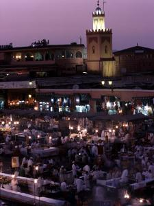 Djemma El-Fna at Dusk with Mosque Behind, Marrakesh, Morocco by Doug McKinlay