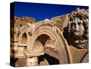 Gorgon Medusa Head on the Arches of the Severan Forum, Leptis Magna, Al Khums, Libya by Doug McKinlay