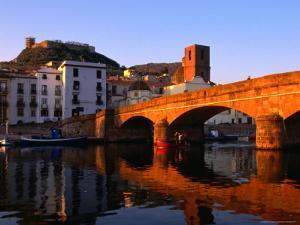 Pontevecchio Bridge Reflected in the River Temo with Castella Malaspina, Bosa, Sardinia, Italy by Doug McKinlay