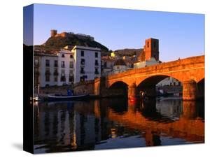 Pontevecchio Bridge Reflected in the River Temo with Castella Malaspina, Bosa, Sardinia, Italy by Doug McKinlay