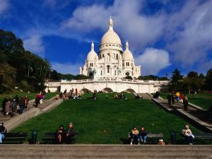 The Sacre Coeur Basilica is Located at the Top of Montmatre (Marty'R Hill) in Paris, France by Doug McKinlay