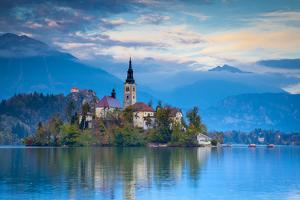 Bled Island with the Church of the Assumption and Bled Castle Illuminated at Dusk, Lake Bled by Doug Pearson