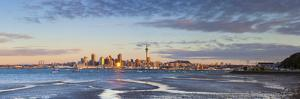 City Skyline and Waitemata Harbour Illuminated at Sunset, Auckland, North Island, New Zealand by Doug Pearson
