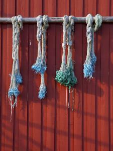 Fishing Nets Hanging from Rorbuer Exterior, Storvagen, Austvagsoya, Lofoten, Nordland, Norway by Doug Pearson