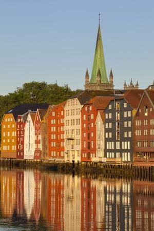Nidaros Cathedral and Old Fishing Warehouses Reflected in the River Nidelva by Doug Pearson