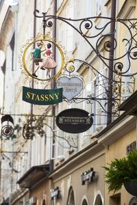 Ornate Shop Signs on Getreidegasse, Salzburgs Bustling Shopping Street, Salzburg by Doug Pearson
