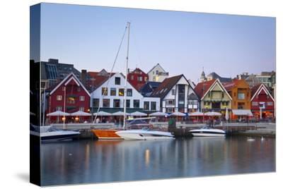 Stavanger's Picturesque Harbor Illuminated at Dusk