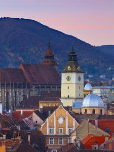 The Black Church and Town Hall Clock Tower Illuminated at Dawn, Piata Sfatului, Brasov, Transylvani by Doug Pearson