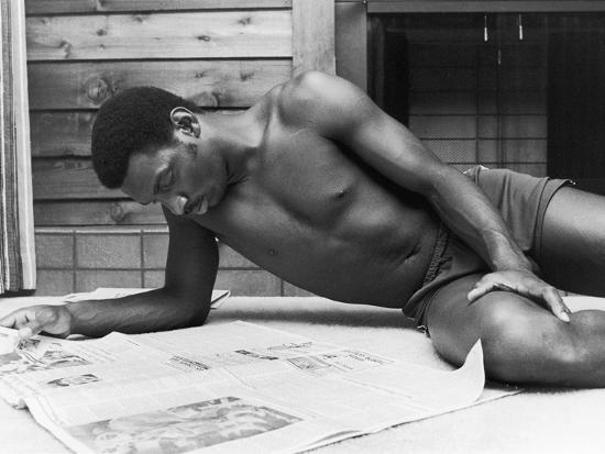 Doug Williams, Reads the Newspaper, 1979-Vandell Cobb-Photographic Print