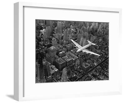 Douglas 4 Flying over Manhattan-Margaret Bourke-White-Framed Premium Photographic Print