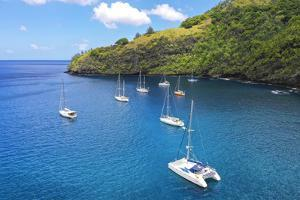 Cruising Yachts anchored, Hapatoni, Tahuata, Marquesas, French Polynesia, South Pacific by Douglas Peebles