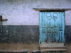 Blue Door and Cross on Wall by Douglas Steakley