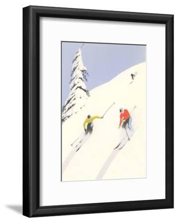 Downhill Skiers in Powder
