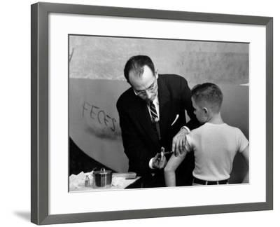 Dr. Jonas Salk Inoculating a Young Boy W. His New Polio Vaccine
