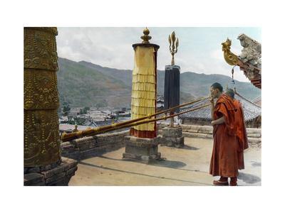 Two Tibetan Monks Summon the Choni Lamas, Using Large Horns