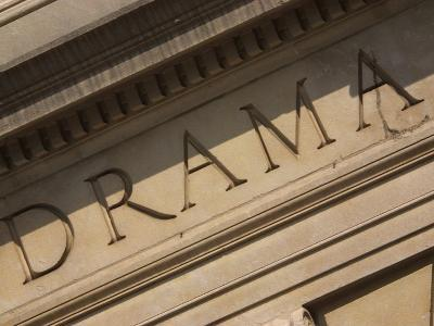 Drama Engraved on Building--Photographic Print