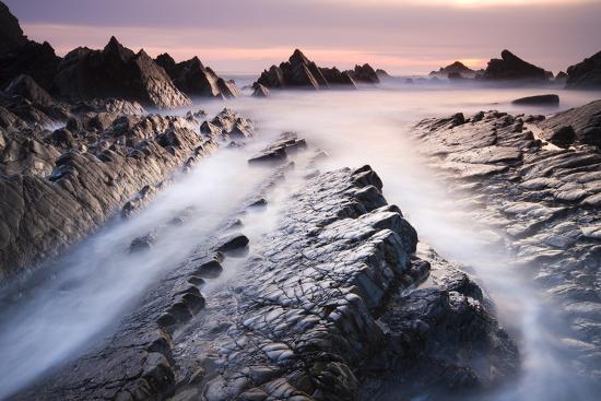 Dramatic coastal scenery at sunset, Hartland Quay, Devon, England. Spring (April) 2010.-Adam Burton-Photographic Print