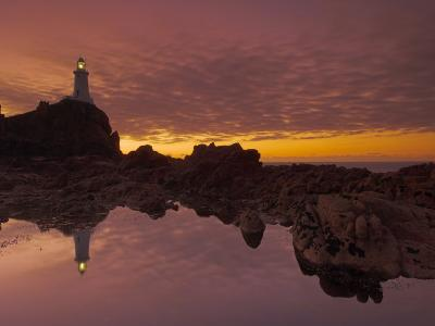 Dramatic Sunset and Low Tide, Corbiere Lighthouse, St. Ouens, Jersey, Channel Islands, UK-Neale Clarke-Photographic Print