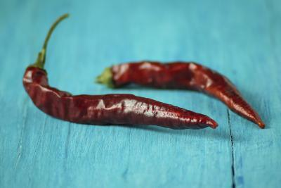 Dried Chillies on Turquoise Wood-Jana Ihle-Photographic Print