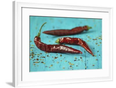 Dried Chillipods on Turquoise Wood-Jana Ihle-Framed Photographic Print