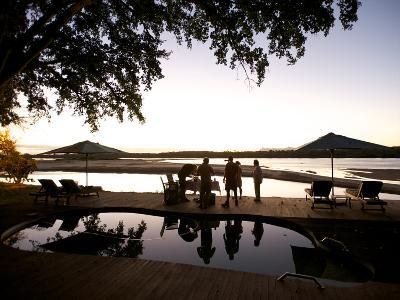Drinks By the Pool At Lugenda Wilderness Camp in the Niassa Reserve-Jad Davenport-Photographic Print