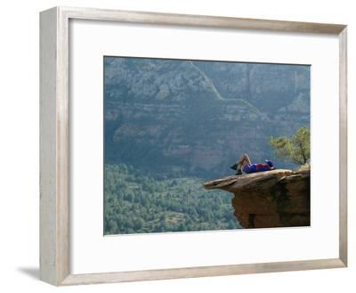 A Hiker Resting at a Cliffs Edge