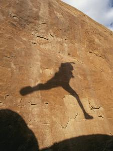 A Hikers Shadow on a Sandstone Wall by Dugald Bremner