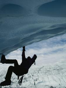 A Man Climbs out of an Ice Cave by Dugald Bremner