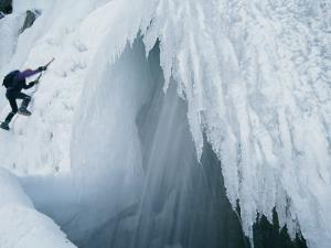 A Man Climbs Outside a Snow Cave by Dugald Bremner